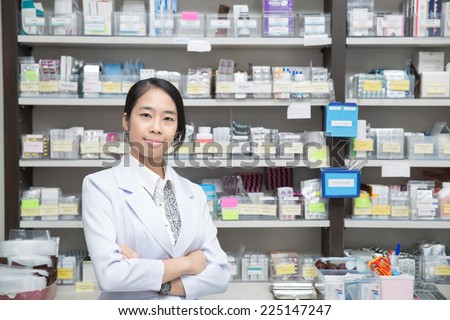 Asian woman a pharmacist in pharmacy room