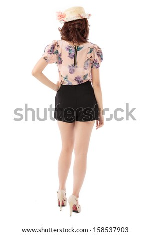 Asian woman full body posing in rosy pastel top and scallop edge skirt shorts with flower top hat isolated on white background.