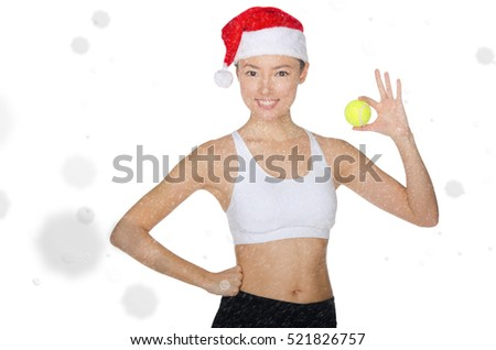 Asian woman holding tennis ball in snow isolated on white