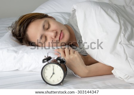 Asian woman sleeping on the bed