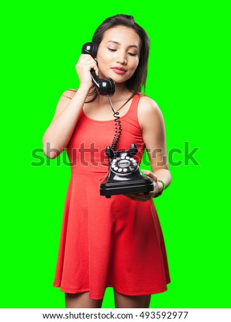asian woman talking on telephone