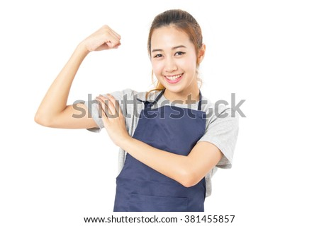 Asian Woman Wearing Apron And Flex Her Muscles Isolated On White.