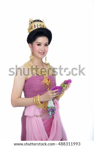 Asian woman wearing typical thai dress. He made a garland of flowers. on white background, identity culture of thailand,Loy Kratong Festival