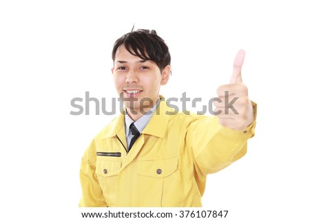 Asian worker showing thumbs up sign