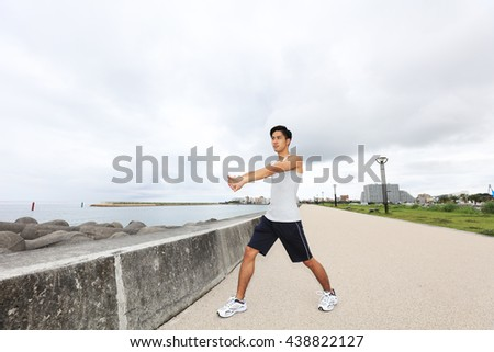 Asian young man doing stretching
