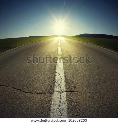 asphalt of country road in backlight