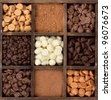 Assorted chocolates, cacao, dark, semisweet, white, milk, butterscotch, and peanut butter, chips in a printers box - stock photo
