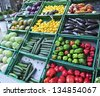 assorted fruit and vegetable trays in the street market - stock photo