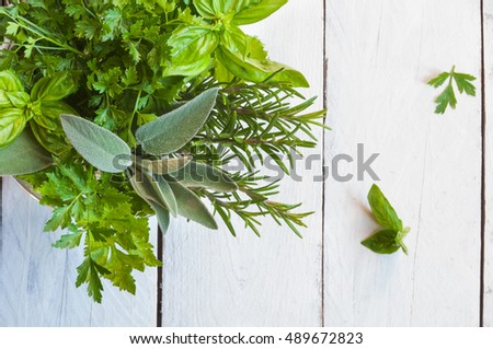 Assorted herbs on wooden table