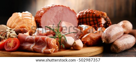Assorted meat products including ham and sausages.