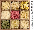 Assorted pasta in a wooden box - stock photo