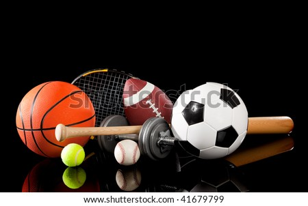 Assorted sports equipment including a basketball, soccer ball, tennis ball, baseball, bat, tennis racket, football and dumbbells on a black background