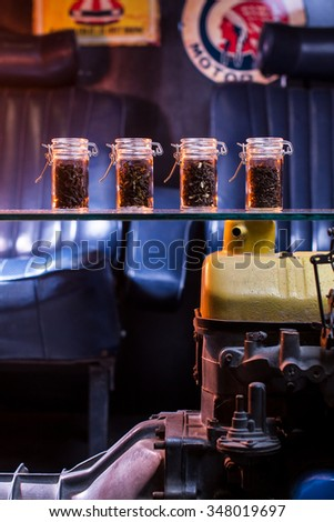 Assortment of dry tea in bottle, with vintage background