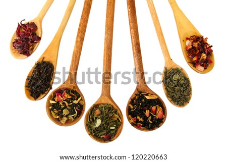 assortment of dry tea in spoons, isolated on white