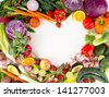 Assortment of Fresh Vegetables and Fruits Making Heart Shape Frame with White Middle - stock photo
