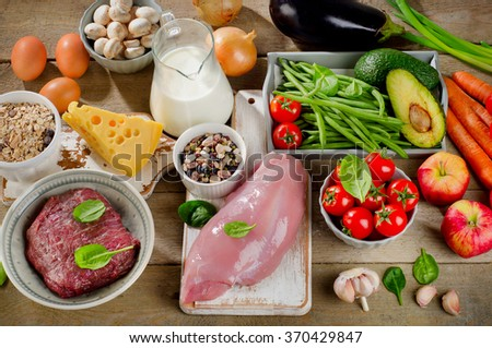 Assortment of Fresh Vegetables and Meats for Healthy Diet on a rustic table. Top view