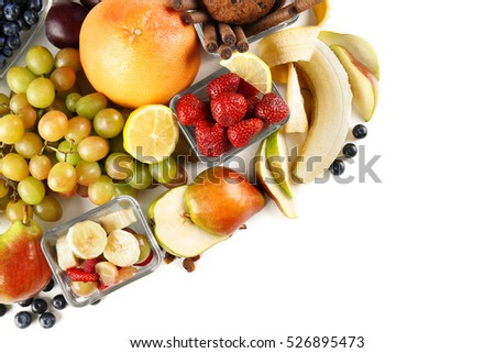 Assortment of fruits, berries and sweets on white background, closeup