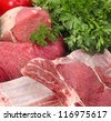 assortment of raw meat with vegetables - stock photo
