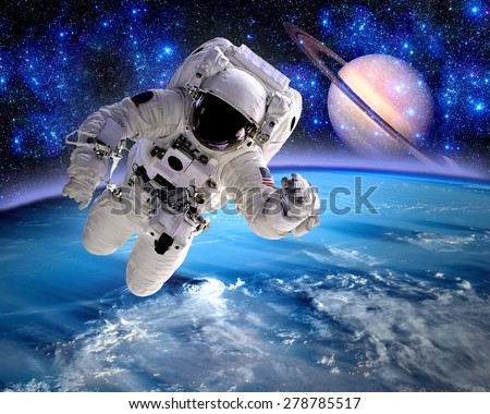 Astronaut spaceman cosmonaut suit space Saturn planet. Elements of this image furnished by NASA.