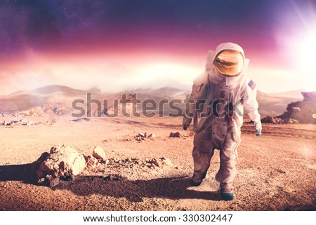"Astronaut walking on an unexplored planet ""Elements of this image were NOT furnished by NASA"""
