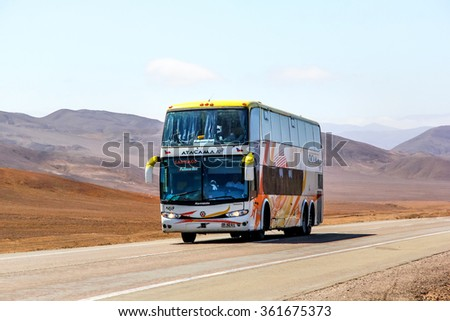 ATACAMA, CHILE - NOVEMBER 14, 2015: Interurban double-decker coach Marcopolo Paradiso 1800DD at the intercity freeway through the Atacama desert.