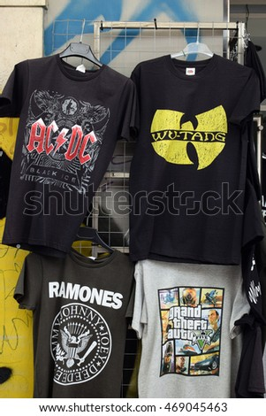 ATHENS, GREECE - AUGUST 4, 2016: Rock and hip hop music t-shirts for sale printed with band logos by The Ramones, AC/DC, Wu-Tang Clan and video game Grand Theft Auto.