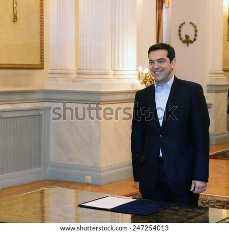 Athens, Greece, Jan. 26, 2015. Greece's Prime Minister Alexis Tsipras, is sworn in with a secular oath by the Greek President Karolos Papoulias at the Presidential Palace in Athens.