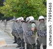 ATHENS, GREECE - JUNE 15: General strike against new $40.36 billion austerity program of tax hikes and sell-offs of state property on June 15, 2011 in Athens, Greece. Greek riot police block access to central square - stock photo