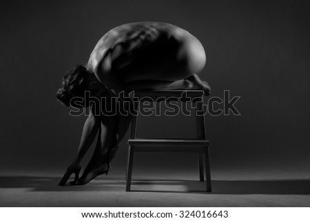 Athletic body of young woman over dark background. Fitness concept.