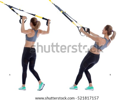 Athletic woman performing a functional exercise with suspension cable.