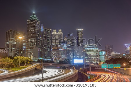 Atlanta, GA, USA - July 11, 2015: Night view of downtown Atlanta shot on a long exposure to capture the beauty of the lights.