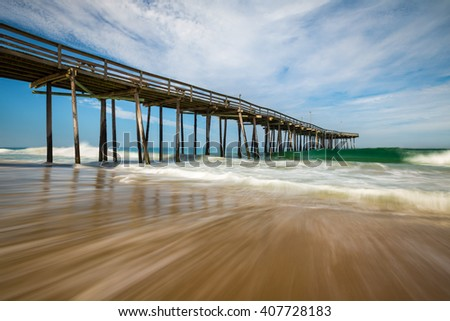 Atlantic Ocean Beach Seascape Outer Banks North Carolina Nags Head NC fishing pier and waves on the east coast