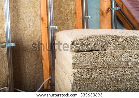 Attick loft insulation pacage rock wool stock photo for Rocks all insulation
