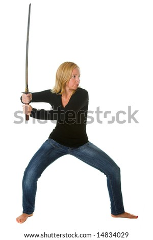 Attractive blond woman in attack position with Samurai sword. Portion of photographers commission of this image will be donated to Autism Ontario.