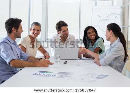 Attractive business people discussing at a business meeting in the office