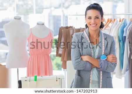 Attractive designer with arms crossed in a studio