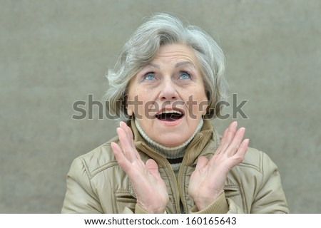 attractive elderly woman walking in the park alone