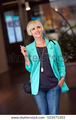 attractive elegant woman walking in the city