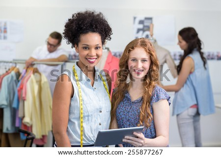 Attractive female fashion designers using digital tablet