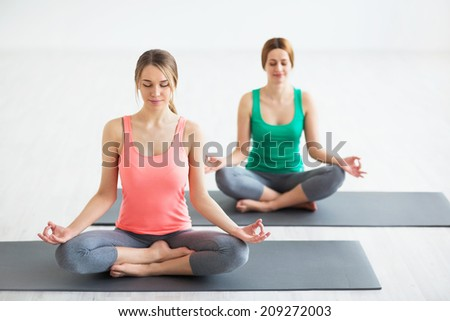 Attractive girl doing yoga