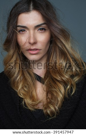 Attractive girl with beautiful hair in a studio posing