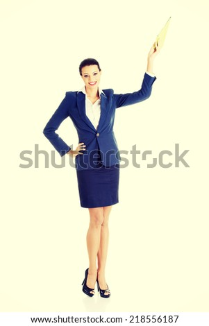 Attractive happy businesswoman, isolated on white