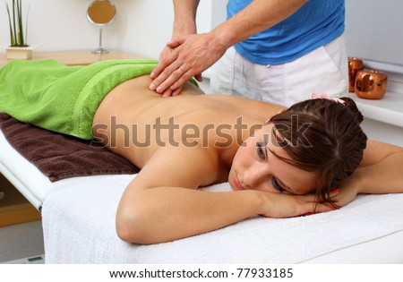 Attractive lady receiving professional massage