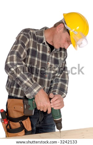 Attractive, middle aged handyman with drill and tool belt, carpenter. Construction concept.