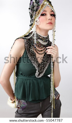 Attractive model in exclusive design clothes on manners old-slavic. Photo.