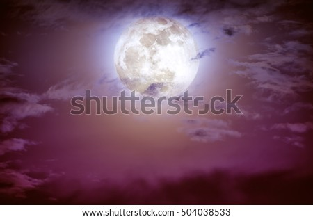 Attractive photo of a nighttime sky with clouds and bright full moon. Nightly sky with beautiful full moon. Outdoors at night.