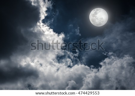 Attractive photo of a nighttime sky with cloudy and bright full moon. Beautiful nature use as background. Outdoors.