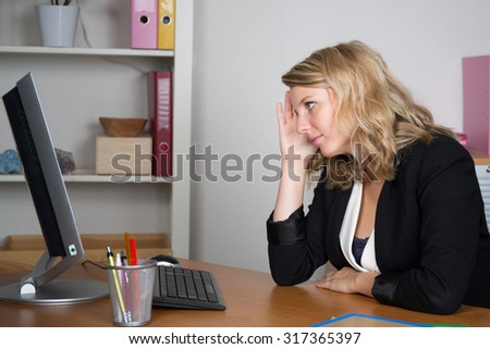 Attractive professional woman working at her office desk