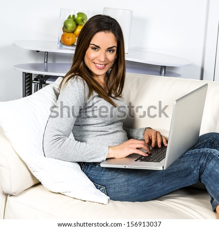 attractive relaxed woman is working at home on a sofa