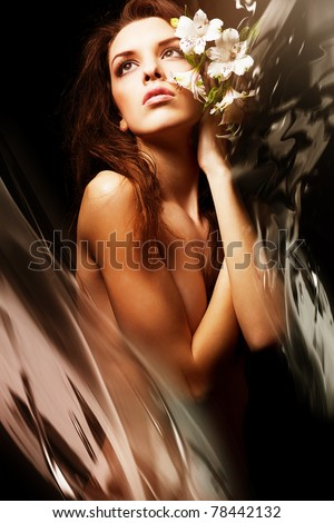 attractive sexy woman with flowers and water